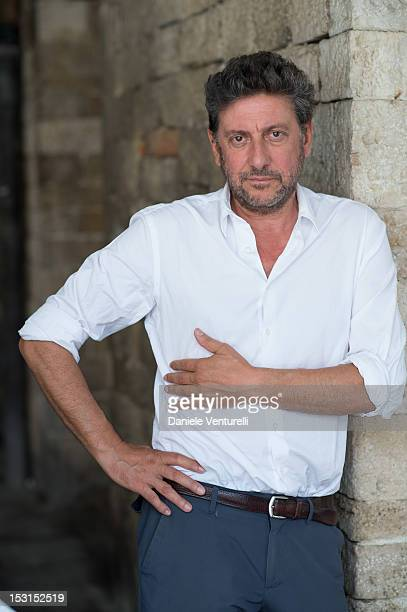 Actor Sergio Castellitto poses during a photocall for the 'Una Famiglia Perfetta' on October 1 2012 in Todi Italy
