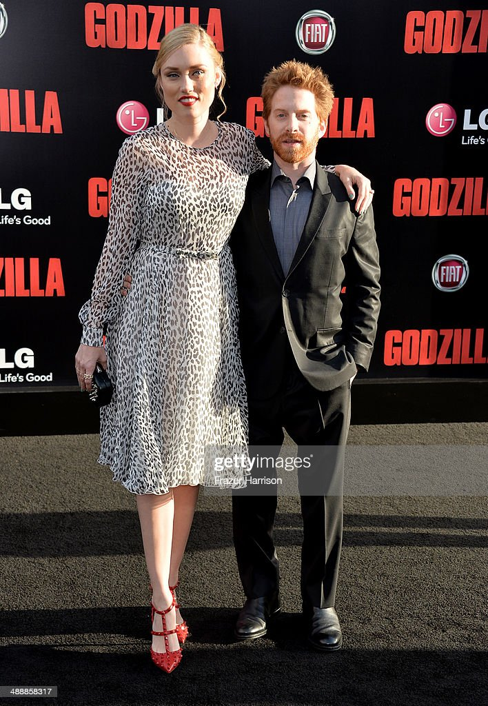 Actor Seth Green (R) and Clare Grant attend the premiere of Warner Bros. Pictures and Legendary Pictures' 'Godzilla' at Dolby Theatre on May 8, 2014 in Hollywood, California.