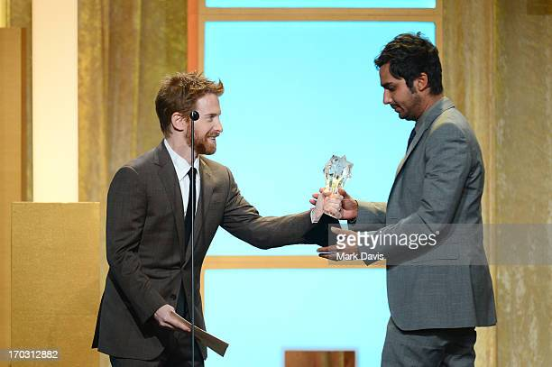 Actor Seth Green presents the award for Best Supporting Actor in a Comedy Series to actor Kunal Nayyar on behalf of actor Simon Helberg onstage...