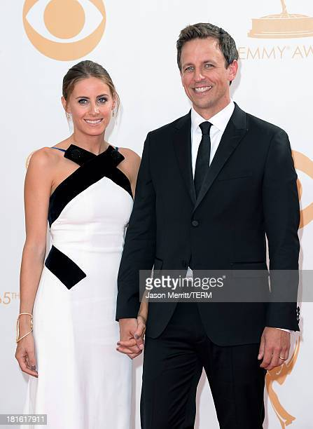 Actor Seth Meyers and wife Alexi Ashe arrive at the 65th Annual Primetime Emmy Awards held at Nokia Theatre LA Live on September 22 2013 in Los...