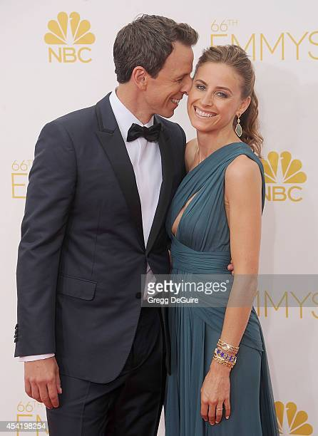 Actor Seth Meyers and wife Alexi Ashe arrive at the 66th Annual Primetime Emmy Awards at Nokia Theatre LA Live on August 25 2014 in Los Angeles...