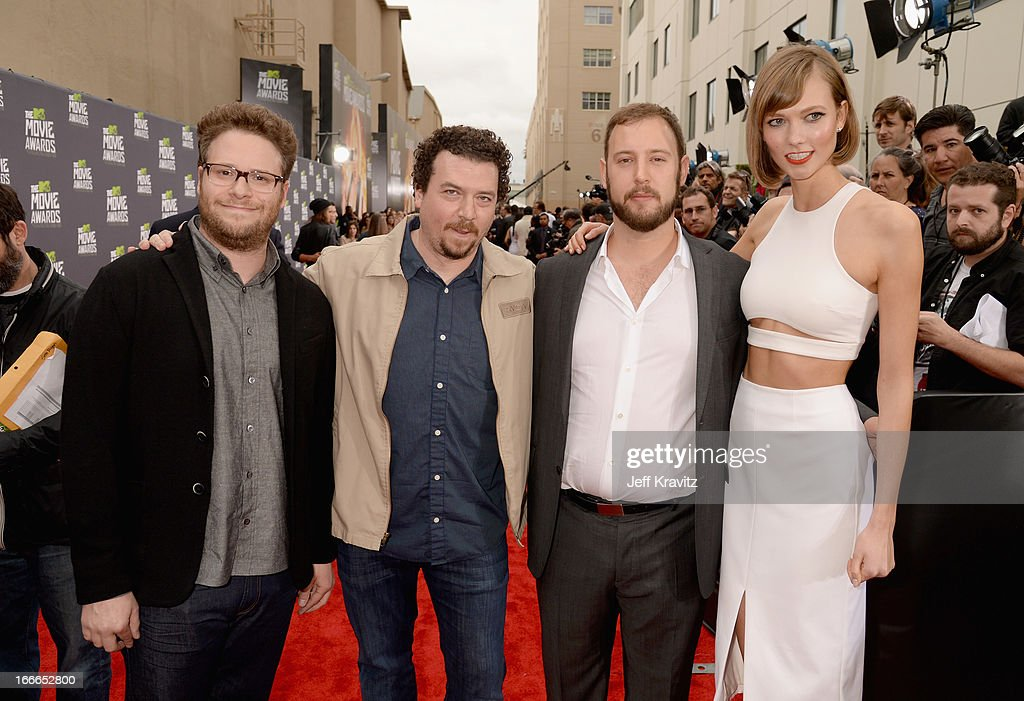 Actor Seth Rogen, actor Danny McBride, director Evan Goldberg and model Karlie Kloss attend the 2013 MTV Movie Awards at Sony Pictures Studios on April 14, 2013 in Culver City, California.