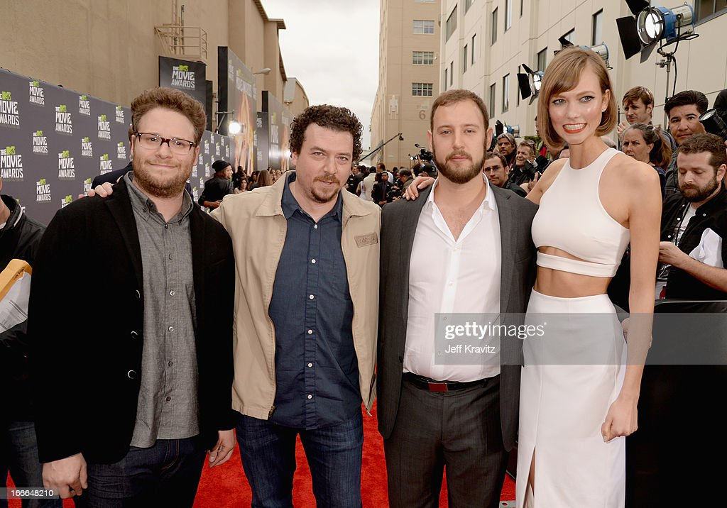 Actor <a gi-track='captionPersonalityLinkClicked' href=/galleries/search?phrase=Seth+Rogen&family=editorial&specificpeople=3733304 ng-click='$event.stopPropagation()'>Seth Rogen</a>, actor Danny McBride, writer/director <a gi-track='captionPersonalityLinkClicked' href=/galleries/search?phrase=Evan+Goldberg&family=editorial&specificpeople=4455825 ng-click='$event.stopPropagation()'>Evan Goldberg</a> and fashion model <a gi-track='captionPersonalityLinkClicked' href=/galleries/search?phrase=Karlie+Kloss&family=editorial&specificpeople=5555876 ng-click='$event.stopPropagation()'>Karlie Kloss</a> attend the 2013 MTV Movie Awards at Sony Pictures Studios on April 14, 2013 in Culver City, California.