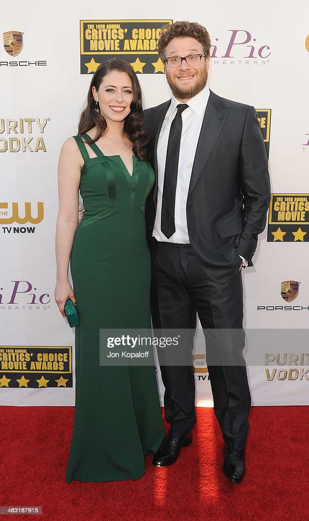 Actor Seth Rogen and wife Lauren Miller arrive at the 19th Annual Critics' Choice Movie Awards at Barker Hangar on January 16, 2014 in Santa Monica, California.