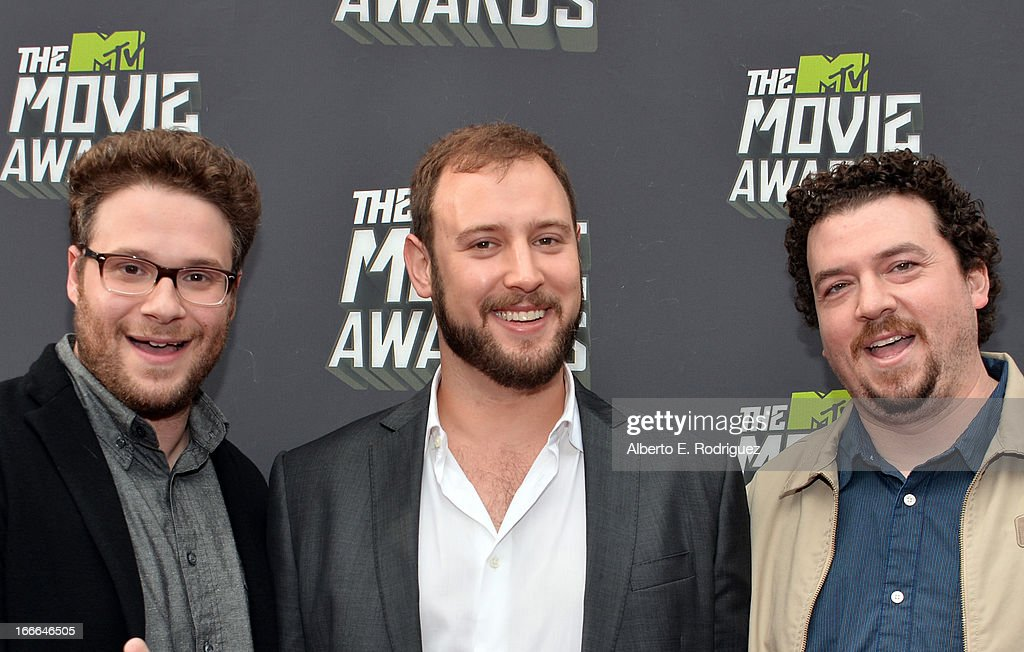 Actor Seth Rogen, director <a gi-track='captionPersonalityLinkClicked' href=/galleries/search?phrase=Evan+Goldberg&family=editorial&specificpeople=4455825 ng-click='$event.stopPropagation()'>Evan Goldberg</a> and actor Danny McBride arrive at the 2013 MTV Movie Awards at Sony Pictures Studios on April 14, 2013 in Culver City, California.