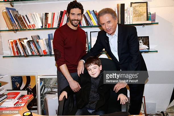 Actor seven years old Victor Cabal and actor Tahar Rahim present the movie 'Le Pere Noel' and TV host Michel Drucker presents the show during the...
