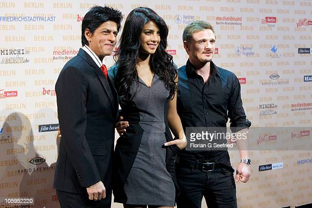 Actor Shah Rukh Khan actress Priyanka Chopra and actor Florian Lukas attend a photo call for the film DON 2 at Friedrichstadtpalast on October 22...