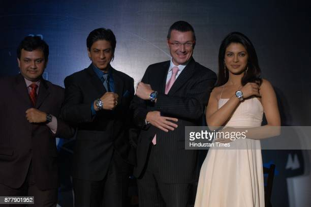Actor Shah Rukh khan along with actress Priyanka Chopra during the launch of new Generation Electro mechanical watch at the press conference in New...