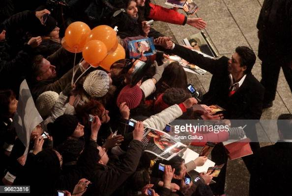 Actor Shah Rukh Khan greets fans as he arrives for the premiere of 'My Name Is Khan' at the 60th Berlinale Film Fesival at Berlinale Palace on...