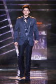 Actor Shah Rukh Khan walks the ramp for designer Varun Bahl show in collaboration with director Karan Johar at the last day of the HDIL India Couture...