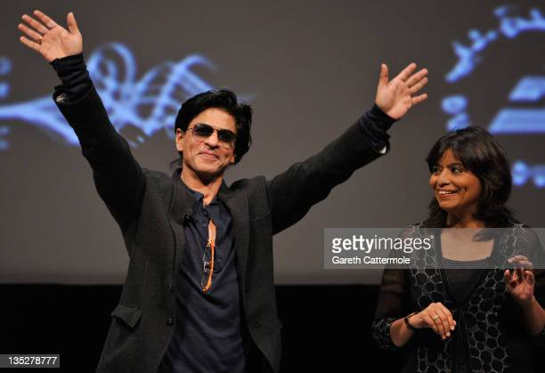 Actor Shah Rukh Khan waves to fans ahead of an QA session during day two of the 8th Annual Dubai International Film Festival held at the Madinat...