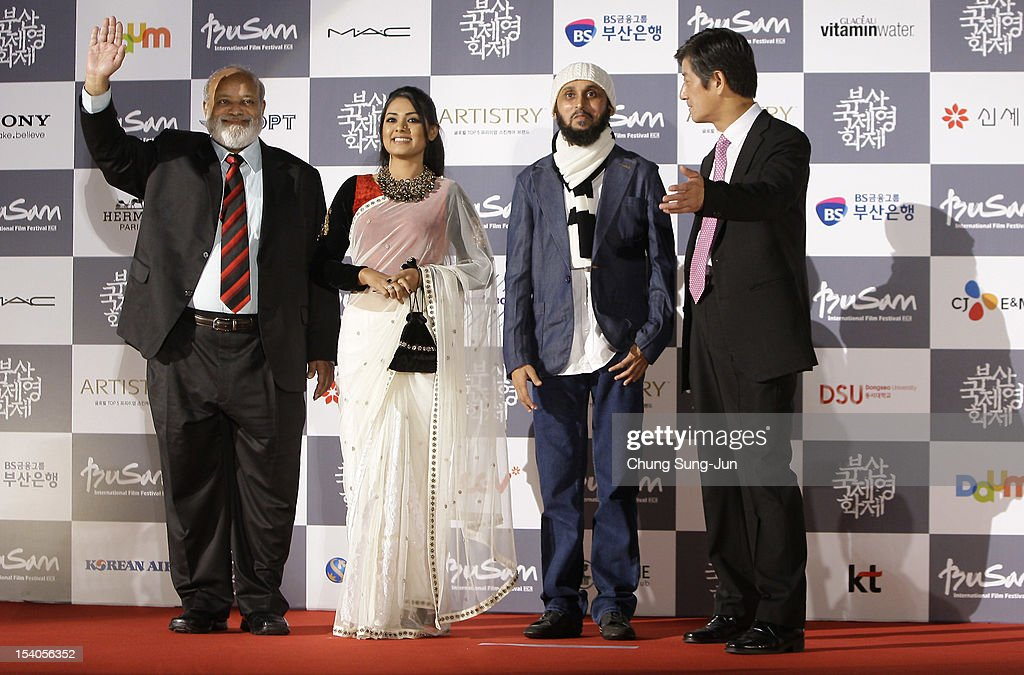 Actor Shahir Kazi Huda, actress Nusrat Imrose Tisha, director Mostofa Farooki and festival director Lee Yong-Kwan arrive for the closing ceremony during the 17th Busan International Film Festival (BIFF) at the Busan Cinema Center on October 13, 2012 in Busan, South Korea. The biggest film festival in Asia showcases 304 films from 75 countries and runs from October 4-13.