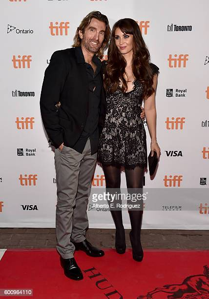 Actor Sharlto Copley and Tanit Phoenix attend the 'Free Fire' premiere screening party hosted by Bulleit at Early Mercy on September 8 2016 in...