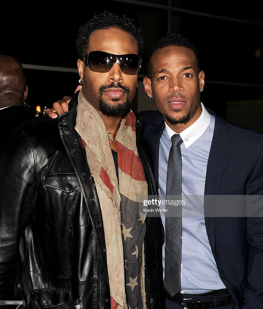 Actor Shawn Wayans (L) and co-writer/producer/actor Marlon Wayans arrive at the premiere of Open Road Films' 'A Haunted House' at the Arclight Theatre on January 3, 2013 in Los Angeles, California.