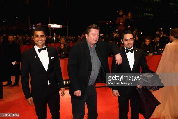 Actor Sherwan Haji director Aki Kaurismaki and actor Simon Hussein AlBazoon arrive for the closing ceremony of the 67th Berlinale International Film...