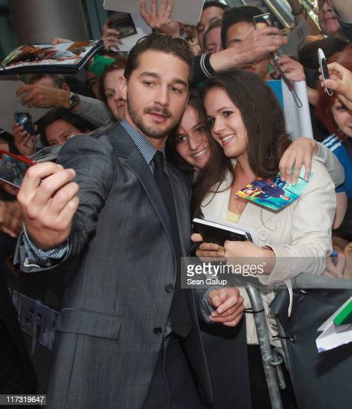 Actor Shia LaBeouf takes a snapshot with a fan as he attends the 'Transformers 3' European premiere on June 25 2011 in Berlin Germany