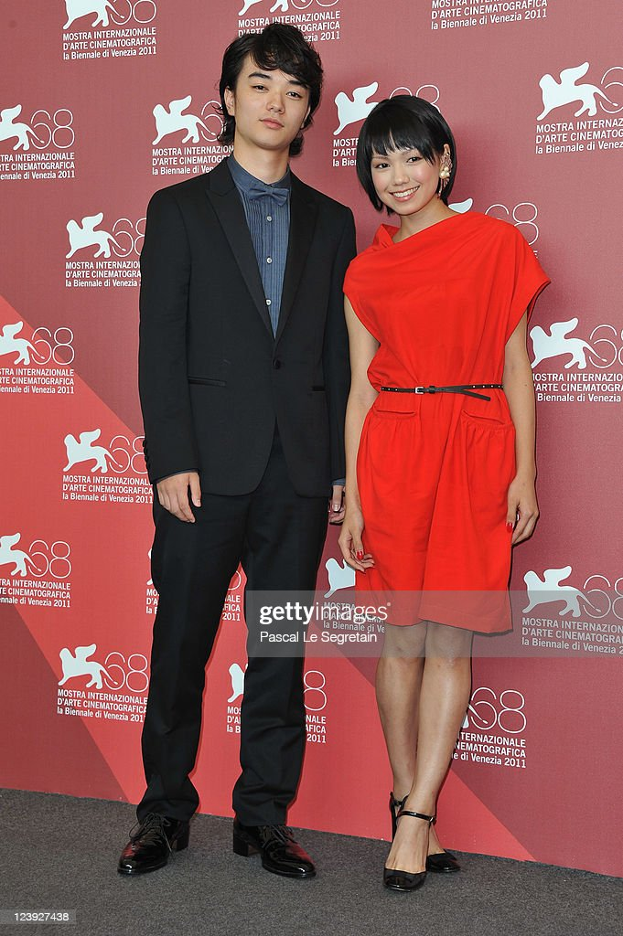 Actor Shota Sometani and actress Fumi Nikaido pose at the 'Himizu' Photocall at the Palazzo del Cinema during the 68th Venice Film Festival on...