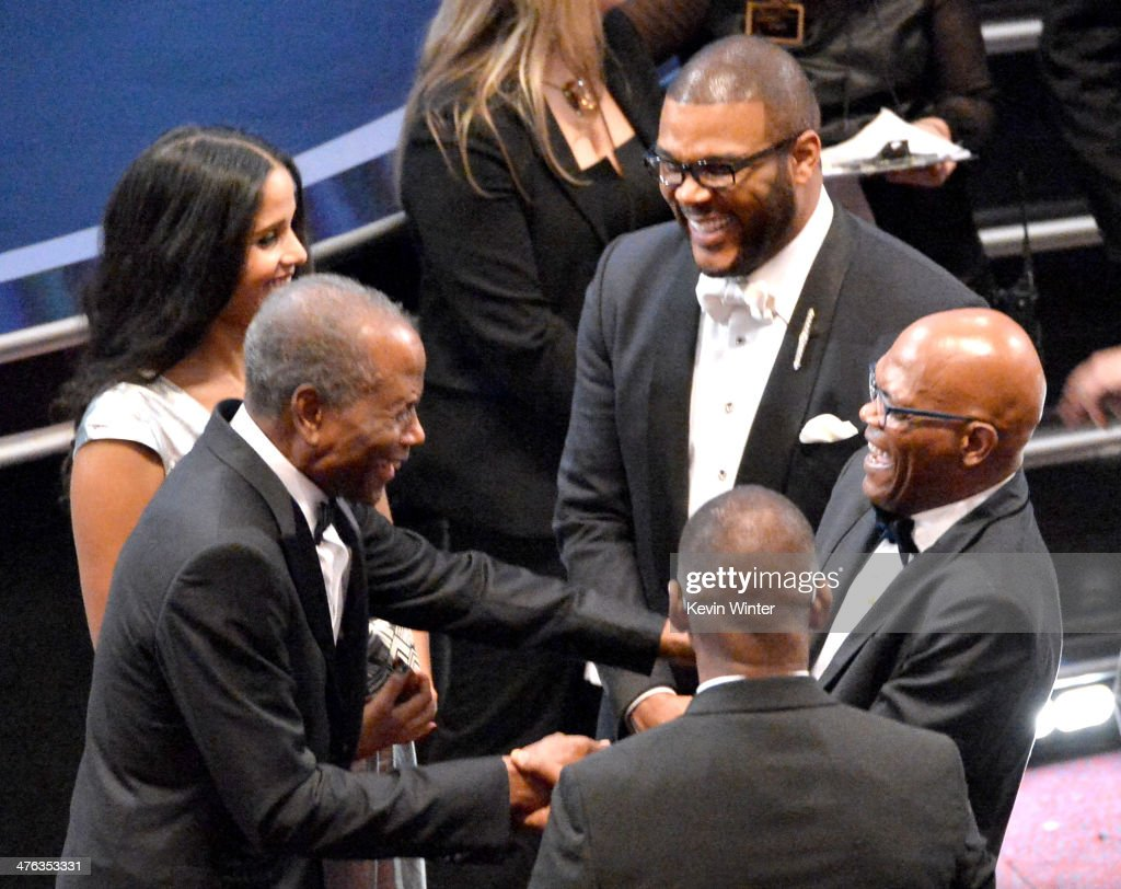 Actor <a gi-track='captionPersonalityLinkClicked' href=/galleries/search?phrase=Sidney+Poitier&family=editorial&specificpeople=94086 ng-click='$event.stopPropagation()'>Sidney Poitier</a> and daughter <a gi-track='captionPersonalityLinkClicked' href=/galleries/search?phrase=Sydney+Tamiia+Poitier&family=editorial&specificpeople=1518726 ng-click='$event.stopPropagation()'>Sydney Tamiia Poitier</a> (L), <a gi-track='captionPersonalityLinkClicked' href=/galleries/search?phrase=Tyler+Perry&family=editorial&specificpeople=678008 ng-click='$event.stopPropagation()'>Tyler Perry</a> and <a gi-track='captionPersonalityLinkClicked' href=/galleries/search?phrase=Samuel+L.+Jackson&family=editorial&specificpeople=167234 ng-click='$event.stopPropagation()'>Samuel L. Jackson</a> (R) attend the Oscars at the Dolby Theatre on March 2, 2014 in Hollywood, California.