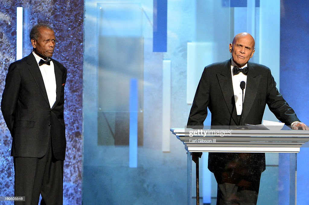 Actor Sidney Poitier (L) and Singer Harry Belafonte, Spingarn Medal honoree, speak onstage during the 44th NAACP Image Awards at The Shrine Auditorium on February 1, 2013 in Los Angeles, California.