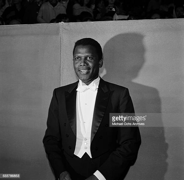 Actor Sidney Poitier attends The 36th Academy Awards in Santa MonicaCA