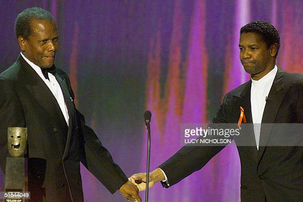 US actor Sidney Poitier is congratulated by actor Denzel Washington as he accepts the Life Achievement Award at the Sixth Annual Screen Actors Guild...