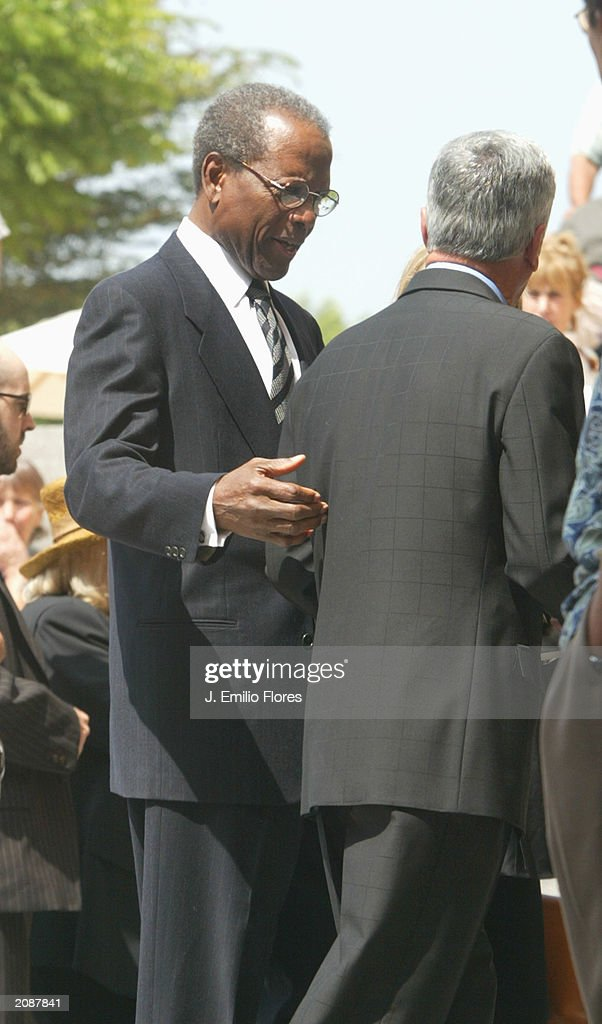 Actor Sidney Poitier leaves the Mass Memorial for actor Gregory Peck June 16, 2003 in Los Angeles, California. The public memorial mass was held a the Our Lady of Angeles Cathedral in Downtown Los Angels.