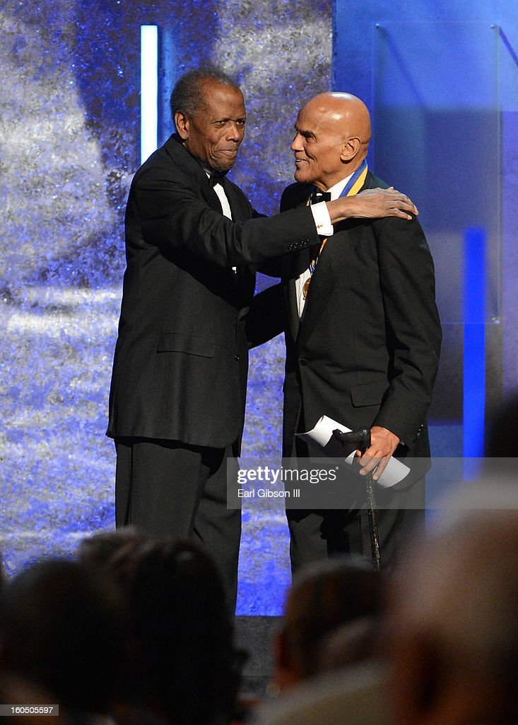 Actor Sidney Poitier (L) presents the Spingarn Medal to honoree Harry Belafonte onstage during the 44th NAACP Image Awards at The Shrine Auditorium on February 1, 2013 in Los Angeles, California.