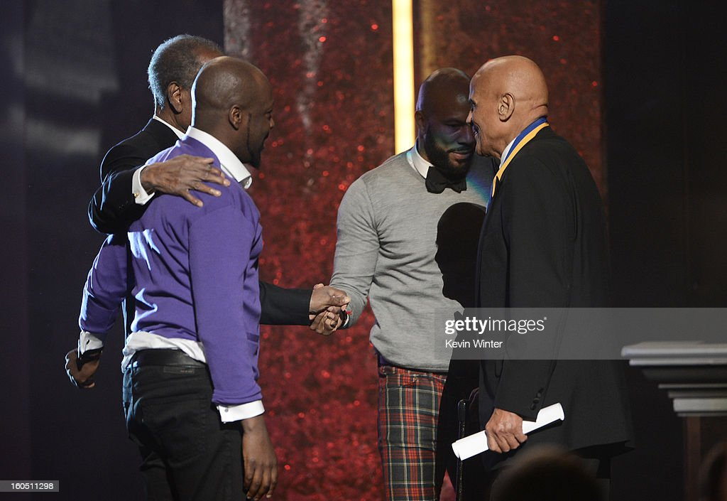 Actor Sidney Poitier, singer Wyclef Jean, rapper-actor Common, and Spingarn Medal honoree Harry Belafonte speak onstage during the 44th NAACP Image Awards at The Shrine Auditorium on February 1, 2013 in Los Angeles, California.