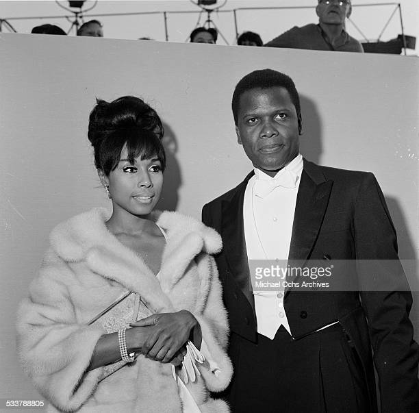 Actor Sidney Poitier with actress Diahann Carroll attend The 36th Academy Awards in Santa MonicaCA