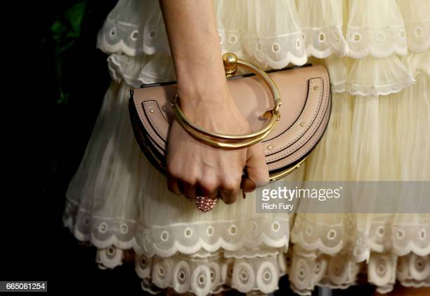 Actor Sienna Miller handbag detail attends the premiere of Amazon Studios' 'The Lost City Of Z' at ArcLight Hollywood on April 5 2017 in Hollywood...