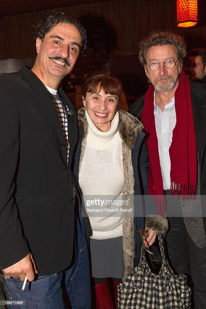 Actor Simon Abkarian, actress Ariane Ascaride and her husband, director Robert Guediguian, pose after Abkarian performed on stage during the premiere of 'Menelas rebetiko rapsodie' he wrote and directed, at Le Grand Parquet on January 9, 2013 in Paris, France.