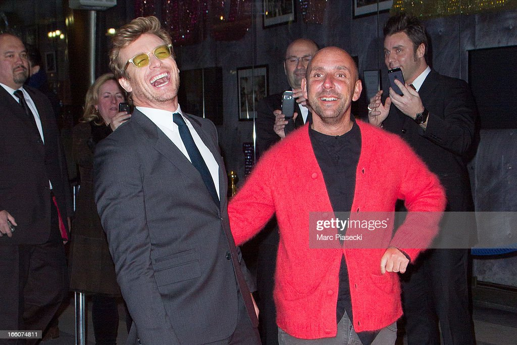 Actor Simon Baker (L) and director Dan Mazer (R) attend the 'Mariage A l'Anglaise' (I Give It A Year) Premiere at Cinema UGC Normandie on April 8, 2013 in Paris, France.