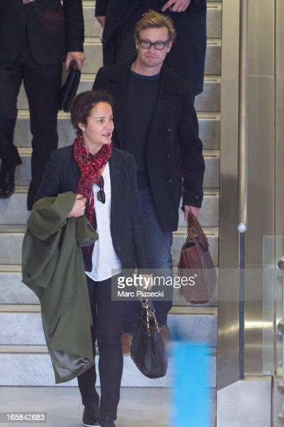 Actor Simon Baker and wife and actress Rebecca Rigg are seen at Roissy airport on April 6 2013 in Paris France