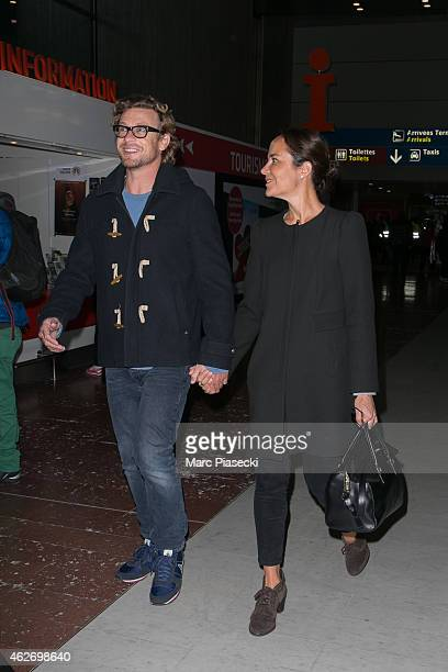 Actor Simon Baker and wife Rebecca Rigg are seen at CharlesdeGaulle airport on February 3 2015 in Paris France