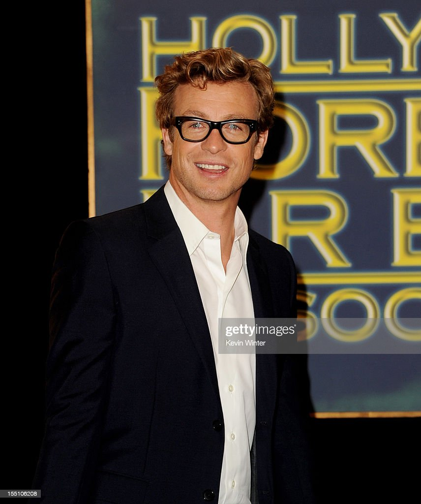Actor Simon Baker poses at the Hollywood Foreign Press Association's announcement of Jodie Foster as the recipient of the Cecil B. DeMille Award at the Beverly Hills Hotel on November 1, 2012 in Beverly Hills, California.