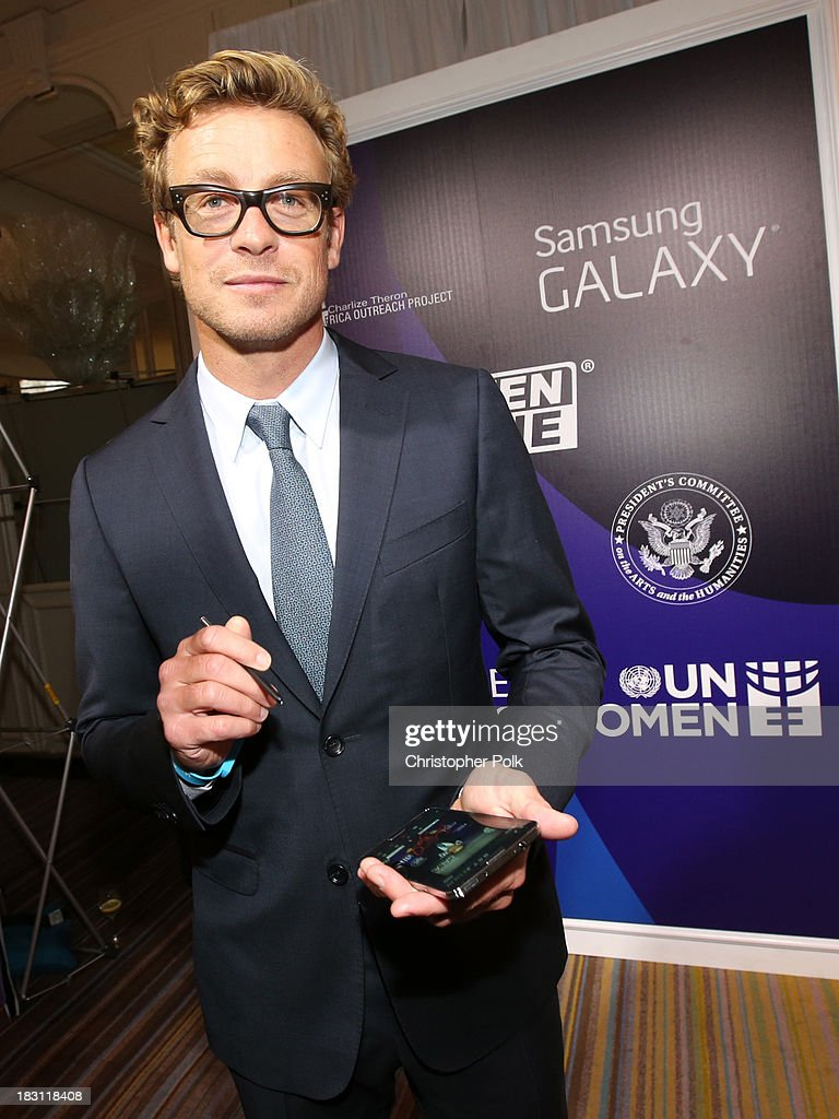 Actor <a gi-track='captionPersonalityLinkClicked' href=/galleries/search?phrase=Simon+Baker&family=editorial&specificpeople=206176 ng-click='$event.stopPropagation()'>Simon Baker</a> signs photo for Samsung's Signatures for Good on the Samsung Galaxy Note 3 at Variety's 5th Annual Power of Women event presented by Lifetime at the Beverly Wilshire Four Seasons Hotel on October 4, 2013 in Beverly Hills, California.
