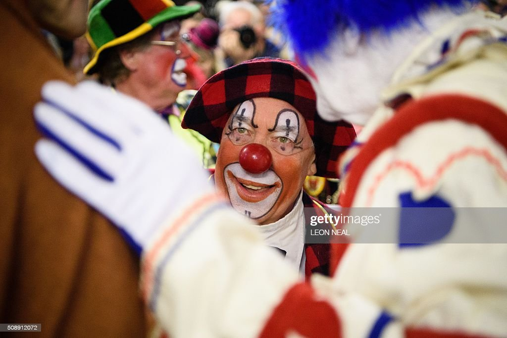 Actor Simon Callow takes part in the 70th annual 'Clowns International' church service at the Holy Trinity church in Dalston in east London, England on February 7, 2016. The service takes place to celebrate the father of modern clowning, Joseph Grimaldi, who died in 1837. / AFP / LEON NEAL