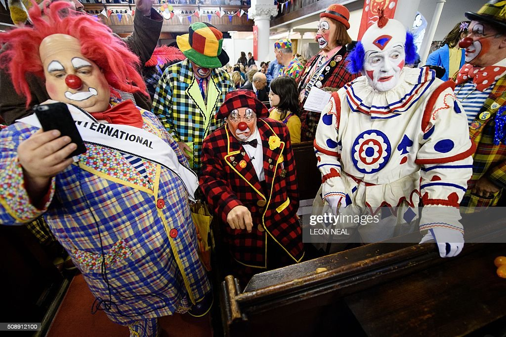 Actor Simon Callow (C) takes part in the 70th annual 'Clowns International' church service at the Holy Trinity church in Dalston in east London, England on February 7, 2016. The service takes place to celebrate the father of modern clowning, Joseph Grimaldi, who died in 1837. / AFP / LEON NEAL