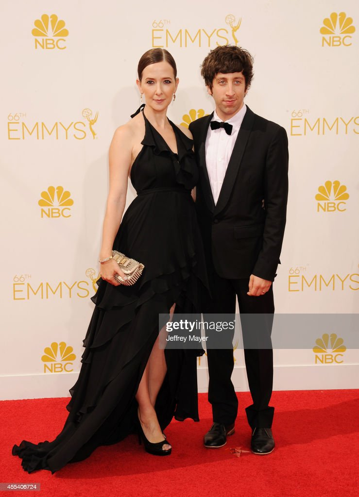 Actor Simon Helberg (R) and Jocelyn Towne arrive at the 66th Annual Primetime Emmy Awards at Nokia Theatre L.A. Live on August 25, 2014 in Los Angeles, California.