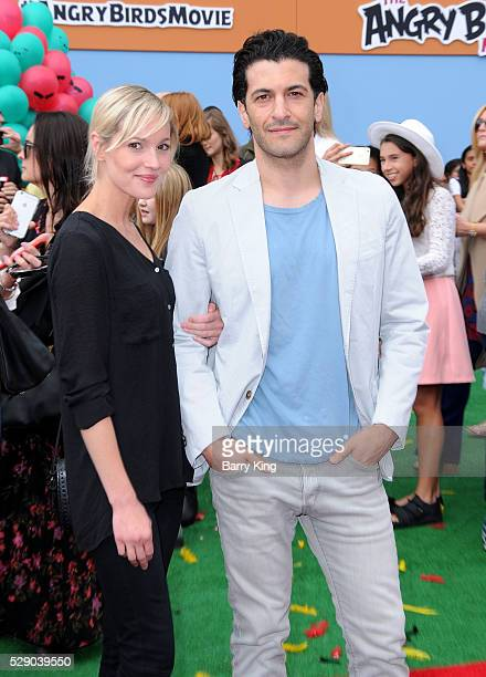 Actor Simon Kassianides and guest attend the premiere of Sony Pictures' 'Angry Birds' at Regency Village Theatre on May 7 2016 in Westwood California