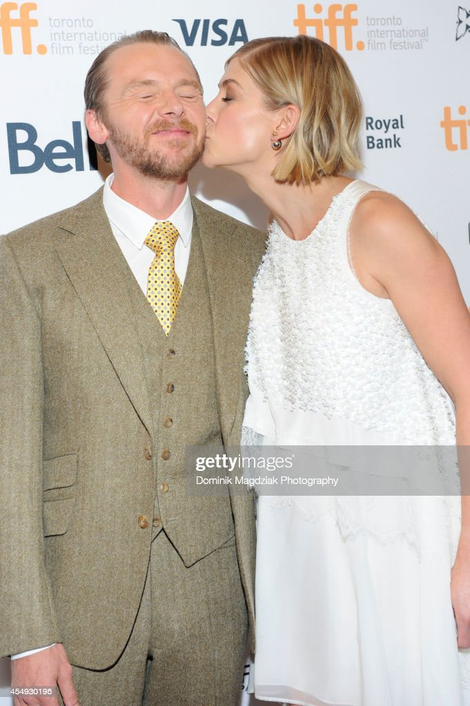 Actor Simon Pegg (L) and actress Rosamund Pike attend the 'Hector And The Search For Happiness' premiere at the Toronto International Film Festival at Winter Garden Theatre on September 7, 2014 in Toronto, Canada.