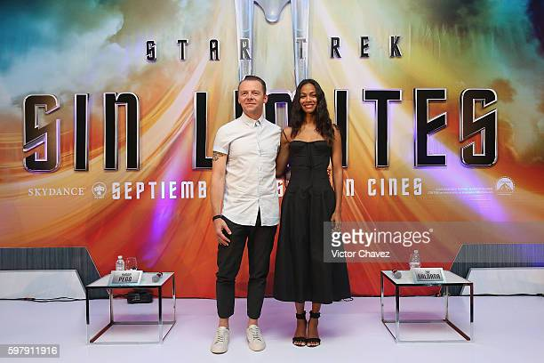 Actor Simon Pegg and actress Zoe Saldana attend a Photocall Press Conference during the promotional tour of the Paramount Pictures title Star Trek...