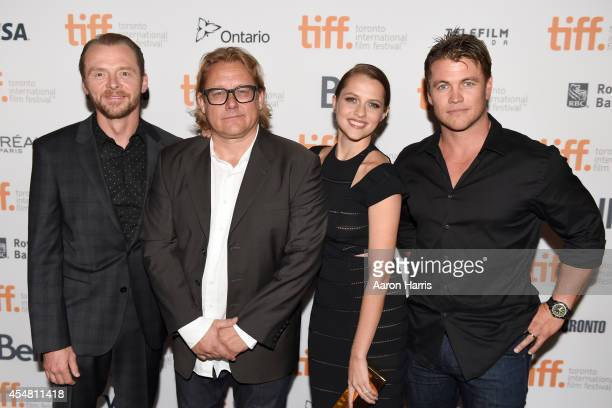 Actor Simon Pegg director Kriv Stenders and actors Teresa Palmer and Luke Hemsworth attend the 'Kill Me Three Times' premiere during the 2014 Toronto...