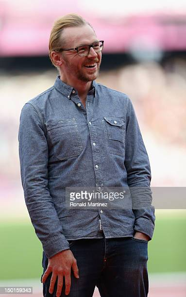 Actor Simon Pegg laughs during an interview before the start of the evning's athleics session on Day 15 of the London 2012 Olympic Games at Olympic...