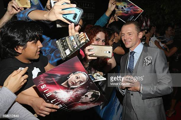 Actor Simon Pegg signs autographs and takes selfies with fans during the promotional tour of the Paramount Pictures title 'Star Trek Beyond' at...