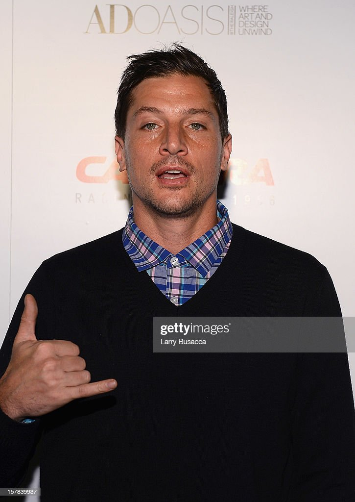 Actor <a gi-track='captionPersonalityLinkClicked' href=/galleries/search?phrase=Simon+Rex&family=editorial&specificpeople=208653 ng-click='$event.stopPropagation()'>Simon Rex</a> arrives to the Carrera Cocktail Party hosted by AD Oasis at The Raleigh on December 6, 2012 in Miami, Florida.