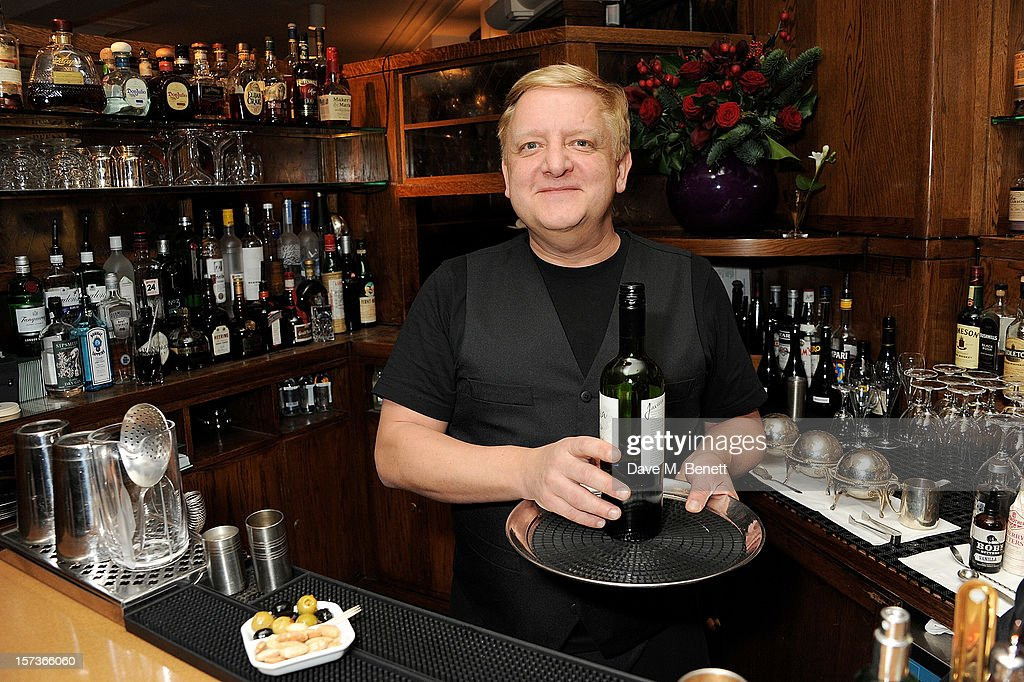 Actor Simon Russell Beale, working as a barman, attends One Night Only at The Ivy, featuring 30 stage and screen actors working as staff during dinner at The Ivy, in aid of The Combined Theatrical Charities, on December 2, 2012 in London, England.