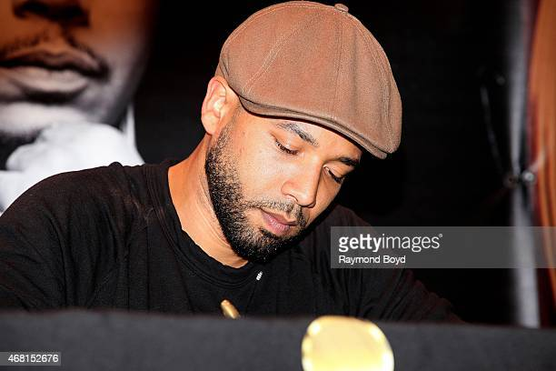 Actor singer and songwriter Jussie Smollett from the FOX TV show 'Empire' signs autographs for fans during the 'Empire' cd signing at the Harold...