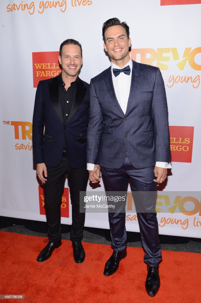 Actor Singer Cheyenne Jackson and Jason Landau attend the Trevor Project's 2014 'TrevorLIVE NY' Event at the Marriott Marquis Hotel on June 16 2014...