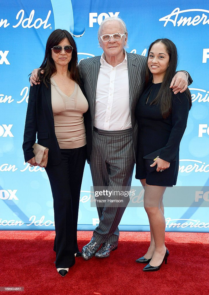 Actor Sir <a gi-track='captionPersonalityLinkClicked' href=/galleries/search?phrase=Anthony+Hopkins&family=editorial&specificpeople=202646 ng-click='$event.stopPropagation()'>Anthony Hopkins</a> (C), wife <a gi-track='captionPersonalityLinkClicked' href=/galleries/search?phrase=Stella+Arroyave&family=editorial&specificpeople=235767 ng-click='$event.stopPropagation()'>Stella Arroyave</a> (L), and guest attend Fox's 'American Idol 2013' Finale - Results Show at Nokia Theatre L.A. Live on May 16, 2013 in Los Angeles, California.